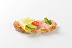 Open faced sandwich. With ham and cheese on white background Royalty Free Stock Photos