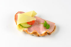 Open faced sandwich. With ham and cheese on white background Stock Images