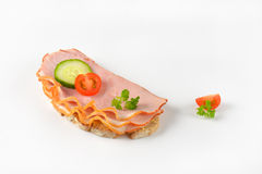Open faced sandwich. Open faced ham sandwich on white background Royalty Free Stock Photography