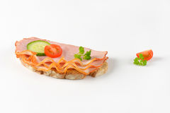 Open faced sandwich. Open faced ham sandwich on white background Royalty Free Stock Photos