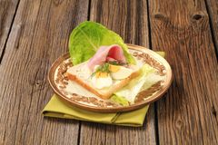 Open faced sandwich. White bread with boiled egg and ham Stock Photo