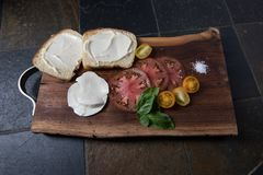 Tomato Sandwich pieces with mozzarella cheese and heirloom tomat stock images