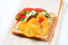 Open faced vegetable sandwich. Open faced tomato and pepper sandwich Stock Images