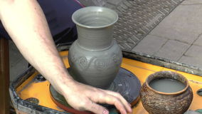 Open Fair Folk. Manufacturing clay vases stock video footage