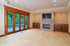 Open Family Room. Large luxurious unfurnished room with lots of upgrade Stock Photography