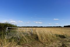Open farm gate. Open metal framed farm gate to farmland field in rural Hampshire royalty free stock images