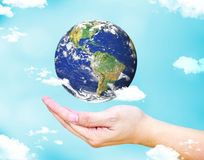 Open female hand with floating  world globe and cloud with light Royalty Free Stock Photography
