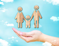 Open female hand with Happy family wood icon with blue sky and c royalty free stock photography