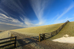 Open fence at the dike of the Waddensea Stock Image