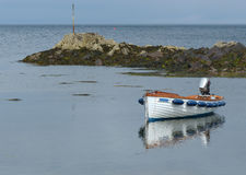 Open fibre glass boat, Garvel Built style, with outboard moored in a little cove at Donaghadee, Co Down. This spot located in the Irish Sea with the Copeland Stock Photos