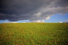 Open Field. With dark clouds Stock Image