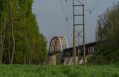 Open field with bridge in background. Royalty Free Stock Photos