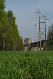 Open field with bridge in background. Stock Photos