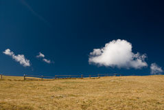 Open field with wooden fence. And deep blue sky Stock Photography
