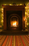 Open Fire. Living room home interior with a cosy open fire Royalty Free Stock Photo