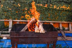 Open fire burning in an outdoor barbecue royalty free stock photography