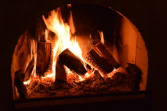 Open fire in fireplace Royalty Free Stock Photos