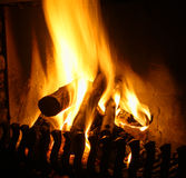 Open fire place. Indoor fire place with logs on fire Stock Photography