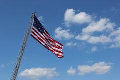 OPen fireman's ladder with American flag Royalty Free Stock Image