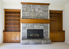 Open Fireplace and Book Shelf Stock Images