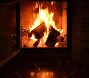 In an open fireplace burning fire royalty free stock photos