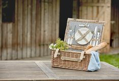 Free Open Fitted Wicker Picnic Hamper On A Garden Table Stock Photography - 122481612