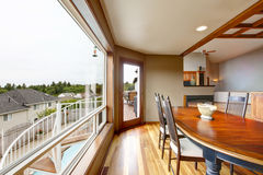 Open floor plan dining area with big window Stock Image