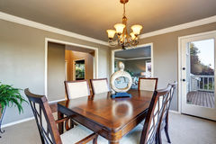 Open floor plan dining area with exit to walkout wooden deck Stock Image