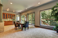Open floor plan dining room with view of kitchen cabinetry Stock Images