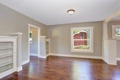 Open floor plan. Empty hallway interior with dark brown hardwood floor. Royalty Free Stock Image
