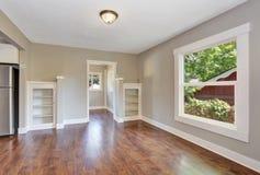 Open floor plan. Empty hallway interior with dark brown hardwood floor. Royalty Free Stock Photography
