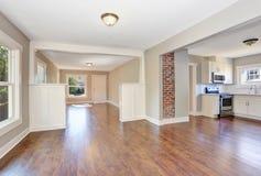 Open floor plan. Empty hallway interior with dark brown hardwood floor. Stock Photo