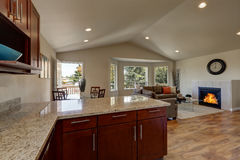 Open floor plan of kitchen, dining and living rooms. With hardwood floor and vaulted ceiling. House interior. Northwest, USA royalty free stock photos