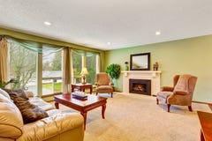 Open floor plan living room interior with green walls. Stock Images