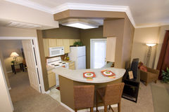 Open floorplan. Large living space of an apartment kitchen that is interior decorated Stock Images