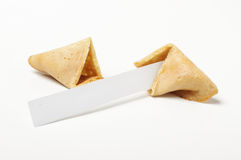 Open fortune biscuit with empty paper Royalty Free Stock Image