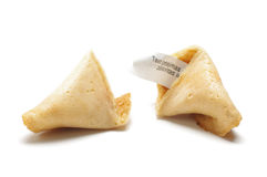 Open fortune cookie with phrase of wisdom inside Stock Photos