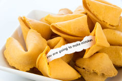 Open fortune cookie - YOU ARE GOING TO MAKE MISTAKES. Open fortune cookie with strip of white paper - YOU ARE GOING TO MAKE MISTAKES stock images