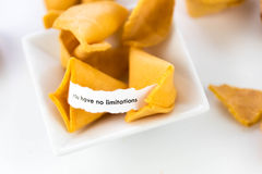 Open fortune cookie - YOU HAVE NO LIMITATIONS Royalty Free Stock Photos