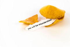 Open fortune cookie - YOU WILL BE MISUNDERSTOOD Stock Images