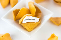 Open fortune cookie - YOU WILL CONQUER Royalty Free Stock Photography