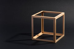 Open frame wooden cube on black Royalty Free Stock Image