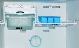 Open freezer compartment. Front shot of open freezer compartment Royalty Free Stock Photo