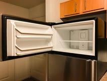 Open freezer door on empty refrigerator. Stainless steel refrigerator with open freezer door.  Freezer is completely empty.  Located in a kitchen Stock Image