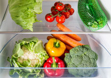 Open fridge filled with fruits and vegetables Royalty Free Stock Images