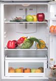 Open fridge with fruits and vegetable Stock Photography