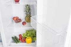 Open fridge full of fresh fruits and vegetables Stock Images
