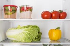 Open fridge full of fresh fruits and vegetables Royalty Free Stock Photo