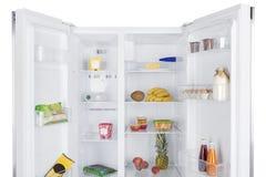 Open fridge full of fresh fruits and vegetables Royalty Free Stock Image