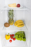 Open fridge full of fresh fruits and vegetables Stock Photos